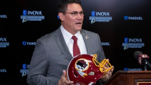 In this Jan. 2, 2020, file photo, Washington Redskins head coach Ron Rivera holds up a helmet during a news conference at the team's NFL football training facility in Ashburn, Va. (AP Photo/Alex Brandon, File)
