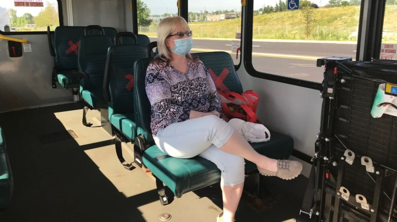 Rider Lori Tellavi wears a mask onboard a St.Thomas, Ont. transit bus on Friday, July 3, 2020. (Sean Irvine / CTV News)