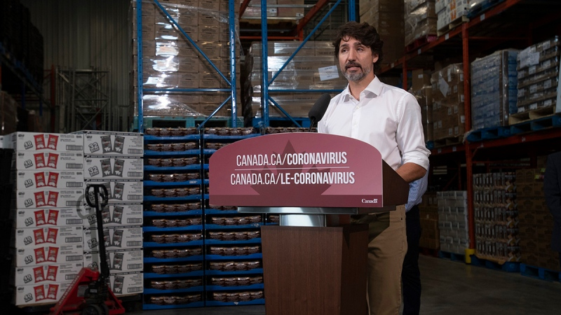 Prime Minister Justin Trudeau responds to a question during a news conference at a food bank in Gatineau, Que., Friday, July 3, 2020. THE CANADIAN PRESS/Adrian Wyld