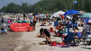 An overcrowded and packed beach is seen in Wasaga Beach, Ont., on Fri., July 3, 2020. (Jim Holmes/CTV News)
