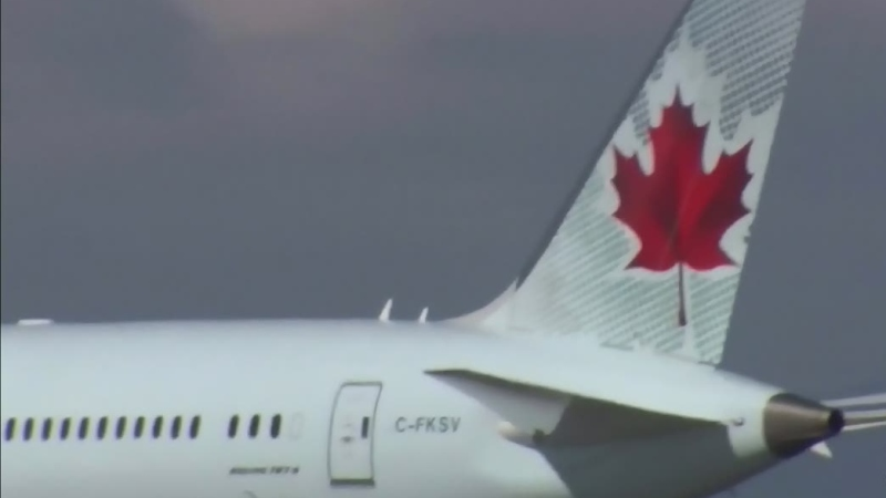MP Don Davies is raising concern over the lack of physical distancing rules on some flights.