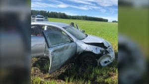 The suspect's vehicle was damaged while fleeing from police near Rocky Mountain House, Alta. (RCMP)