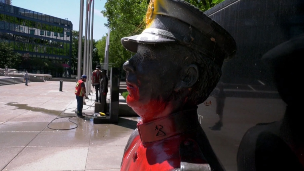 statues, red paint, memorial, police, firefighter,