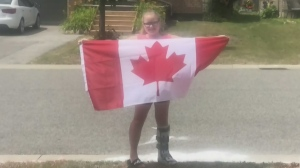 Barrie bylaw has a change of heart over a painted Canadian flag done by a young girl.