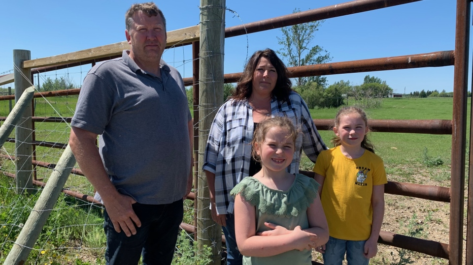 Mark Pastoor and his wife, Diane, are pictured with their grandchildren, who enjoy feeding the bison. (Nicole Di Donato/CTV Saskatoon)