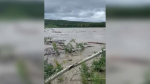 High water on the Smoky River caused officials to issue a mandatory evacuation order for the Hamlet of Watino on July 3, 2020.
