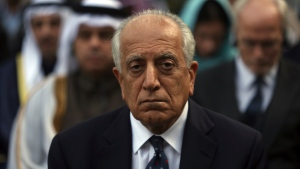 In this March 9, 2020 file photo, Washington's peace envoy Zalmay Khalilzad, attends Ashraf Ghani's inauguration ceremony at the presidential palace in Kabul, Afghanistan. (AP Photo/Rahmat Gul, File)