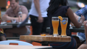 Two beers sit atop a table at an outdoor patio on Somerset St. W. in Ottawa, July 3, 2020. (Taylor Rossi / CTV News Ottawa)