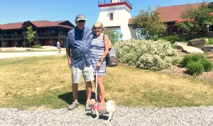 Terri and John Kennedy -- and their dog Maddie --  are vacationing at Killarney Mountain Lodge, one of many Canadians who are visiting the lodge, making up for the American tourists who can't cross the border because of COVID-19. (Alana Everson/CTV News)