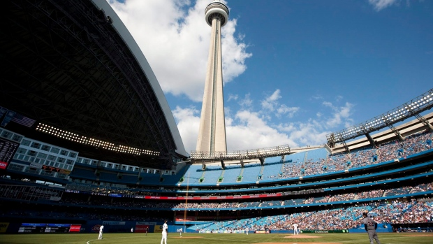 The CN Tower looms over the Toronto Blue Jays and Detroit Tigers in Toronto, Saturday, May 7, 2011. THE CANADIAN PRESS/Darren Calabrese