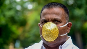 Shankar Kurhade can be seen wearing his gold face mask. (AFP)