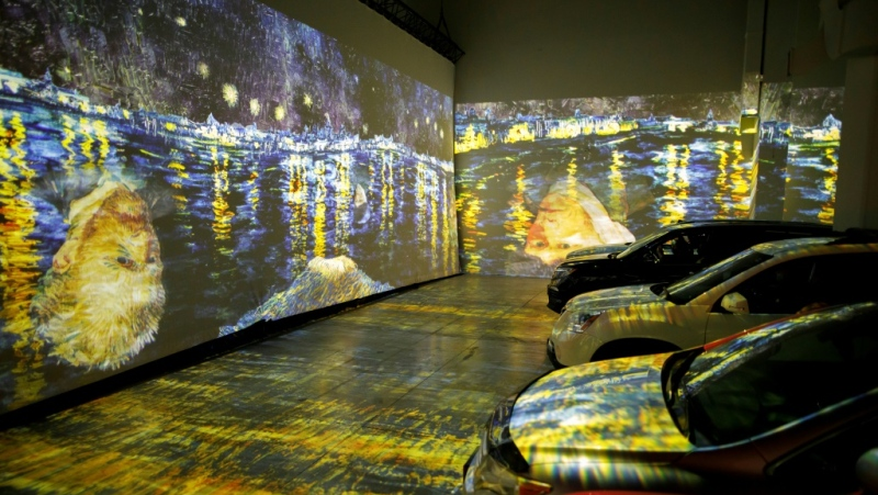 People sit in their cars to experience a drive-in immersive Vincent Van Gogh art exhibit in Toronto on July 3, 2020. (AFP)