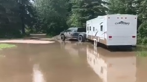 Rising water levels in Whitecourt, Alta. on July 4, 2020 have local residents fearing flooding could soon follow.