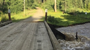 DriveBC posted this photo to their Twitter account on July 3, 2020, saying the Moffat Creek Bridge is washing out on the Horsefly-Woodjam Road near Williams Lake. (DriveBC)