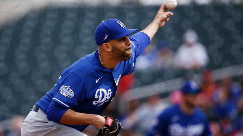In this March 2, 2020, file photo, Los Angeles Dodgers starting pitcher David Price throws against the Cincinnati Reds during the first inning of a spring training baseball game in Goodyear, Ariz. Price will not play this season because of concerns over the coronavirus pandemic, delaying his Los Angeles debut until next year. The five-time All-Star became the latest player to opt out, posting Saturday, July 4, 2020, on Twitter that he would not participate in the 60-game season that is scheduled to begin July 23. (AP Photo/Ross D. Franklin, File)