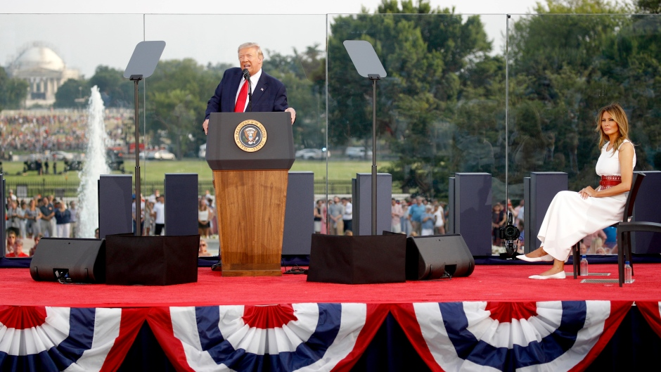"""President Donald Trump, with first lady Melania Trump, speaks during a """"Salute to America"""" event on the South Lawn of the White House, Saturday, July 4, 2020, in Washington. (AP Photo/Patrick Semansky)"""