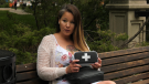 Krista Shore holds a naloxone kit in Regina. Shore encourages more people to keep kits around. (Marc Smith/CTV News Regina)