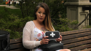 Krista Shore holds a naloxone kit in Regina. Shore encourages more people to keep kits around. (Marc Smith/CTV News Regina)