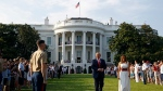 "U.S. President Donald Trump and first lady Melania Trump walk on the South Lawn of the White House during a ""Salute to America"" event, Saturday, July 4, 2020, in Washington. (AP Photo/Patrick Semansky)"
