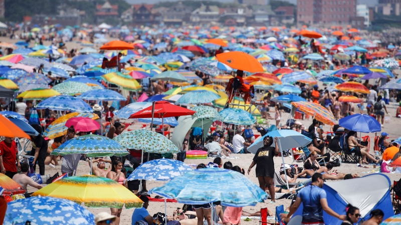 Revelers enjoy the beach at Coney Island, Saturday, July 4, 2020, in the Brooklyn borough of New York. (John Minchillo/AP/CNN)