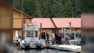 Members of the Haida Nation deliver a letter to a fishing lodge on Haida Gwaii on Saturday, July 4, 2020, asking them not to reopen because of the ongoing risk of COVID-19. (Submitted/DonaldEdgars)