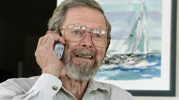 George E. Smith, 79, receives a congratulatory telephone call at his home in Waretown, N.J., on Tuesday, Oct. 6, 2009. (AP / Mel Evans)