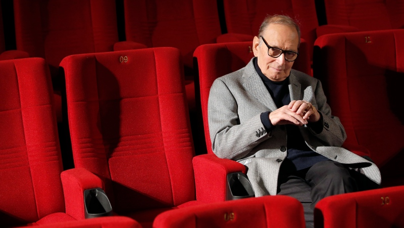 In this Dec. 6, 2013 file photo, Italian composer Ennio Morricone poses during a photo call to promote his German 2014 concerts, in Berlin, Germany. (AP Photo/Michael Sohn, file)