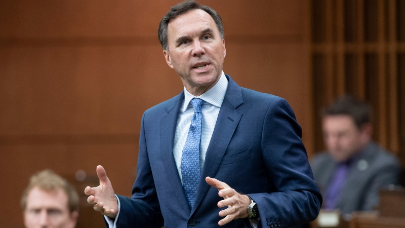 Finance Minister Bill Morneau rises during Question Period in the House of Commons in Ottawa on May 26, 2020. (THE CANADIAN PRESS/Adrian Wyld)