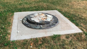 This photo provided by WROC-TV shows the remnants of a Frederick Douglass statue ripped from its base at a park in Rochester, N.Y., Sunday, July 5, 2020. (Ben Densieski/WROC-TV via AP)