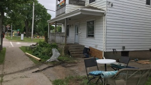 Repairs are made to a home on George Street in Sydney, N.S., after a vehicle crashed into it, leaving a passenger dead, on July 6, 2020. (Kyle Moore/CTV Atlantic)