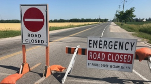 An emergency road closure sign blocks the road as police search for someone who was allegedly seen fleeing after a crash. (Dan Lauckner / CTV Kitchener)