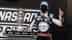 Race driver Kevin Harvick celebrates after winning the NASCAR Cup Series auto race at Indianapolis Motor Speedway in Indianapolis, on July 5, 2020. (Darron Cummings / AP)