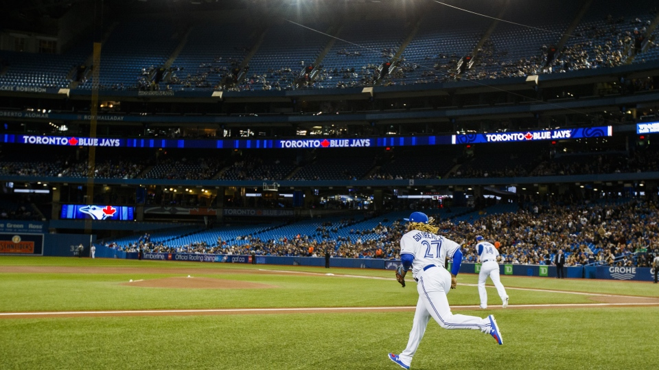 Toronto Blue Jays rookie Vladimir Guerrero Jr. takes the field for his major league debut against the Oakland Athletics during the first inning of MLB baseball action in Toronto, Friday April 26, 2019. The Toronto Blue Jays have been cleared to start their summer training camp at Rogers Centre, but Canada's deputy chief public health officer says hosting other teams there during the regular season would be a