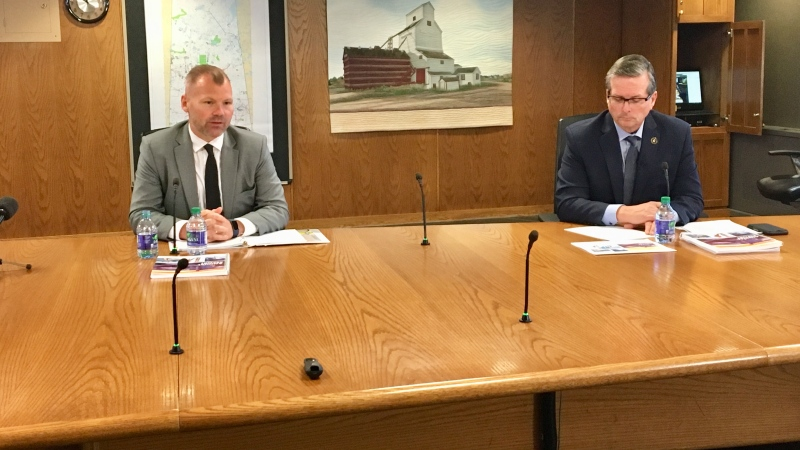Minister Responsible for SaskPower Dustin Duncan, left, and SaskPower President and CEO Mike Marsh, right, present the Crown corporations 2019-20 report. (Gareth Dillistone / CTV News Regina)