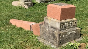 One of 75 memorial stones, many of them large and dating back decades or more, is seen toppled in Avondale Cemetery in Stratford, Ont. on Monday, July 6, 2020. (Sean Irvine / CTV News)
