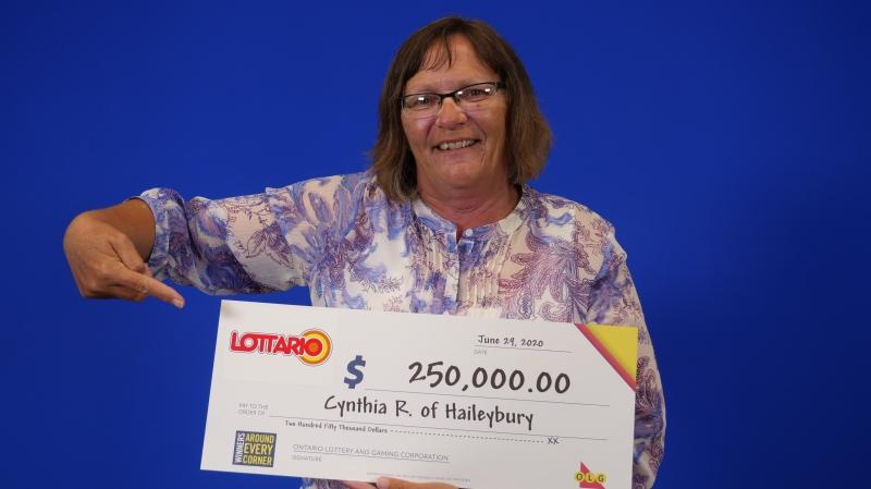 Cynthia Ramsay of Haileybury picking up her Lottario prize winnings in Toronto. (OLG)
