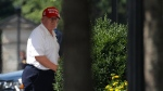 U.S. President Donald Trump arrives at the White House, Sunday, July 5, 2020, in Washington after visiting Trump National Golf Club in Sterling, Va. (AP Photo/Patrick Semansky)
