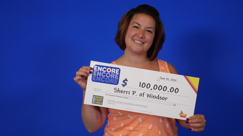 Windsor resident Sherri Pukay with her OLG cheque for $100,000 after winning at ENCORE. (courtesy OLG)