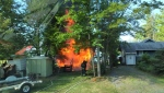 Crews battle a fire at a cottage on Camp Newport Road in Huntsville on Monday, July 6, 2020 (Courtesy Huntsville Fire)