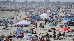 U.S. COVID-19 cases surge on holiday weekend