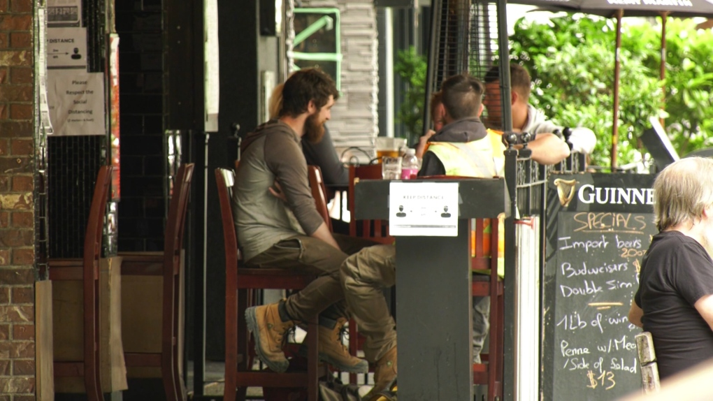 Customers enjoy a restaurant patio in Vancouver.