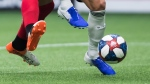 Toronto FC's Terrence Boyd, left, and Vancouver Whitecaps' Scott Sutter vie for the ball during the second half of an MLS soccer game in Vancouver on Friday May 31, 2019. (Darryl Dyck / THE CANADIAN PRESS)