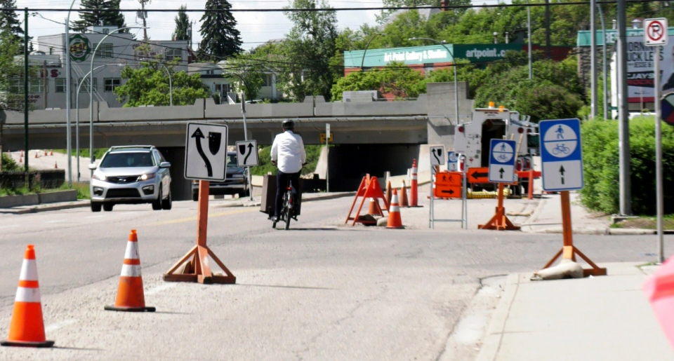 Matthew Hicks navigates a temporary bike lane connecting Ramsay and Inglewood.