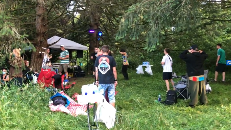People are seen listening to music at Jericho Beach Park, an event that has prompted some concerns about the potential impact of allowing drinking in some public areas of Vancouver.