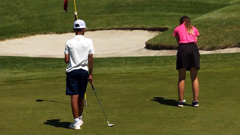 Junior golfer Kelli Yeske putts Monday at McKenzie Meadows Golf Club.