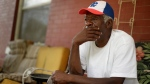 Gerald Armstrong recalls his time working for the old Kansas City Athletics as an attendant and ball boy in the visitor's clubhouse as he speaks from the front porch of the home where he grew up and now lives in Kansas City, Mo., on Friday, June 26, 2020. (AP Photo/Charlie Riedel)