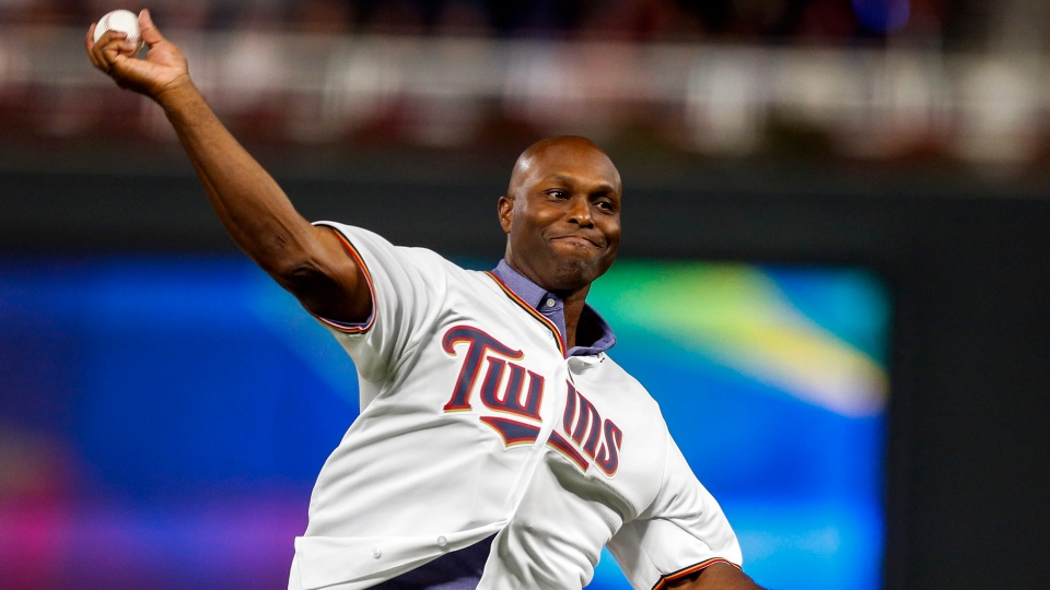 In this Monday, Oct. 7, 2019 file photo, former Minnesota Twins baseball player Torii Hunter throws out the ceremonial first pitch before Game 3 of the American League Division Series between the Twins and the New York Yankees, in Minneapolis.  (AP Photo/Bruce Kluckhohn)