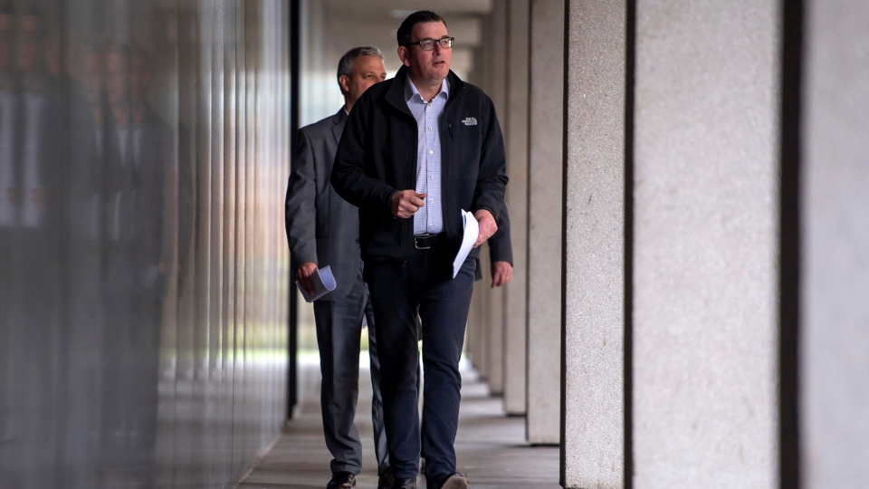 Victorian Premier Daniel Andrews walks to a press conference in Melbourne, Monday, July 6, 2020. (AP Photo/Andy Brownbill)