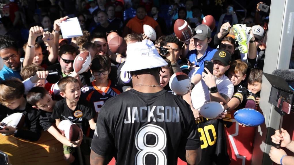 Lamar Jackson signs autographs