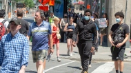 Pedestrians walk on Ste. Catherine Street Thursday, June 18, 2020 in Montreal. (THE CANADIAN PRESS / Ryan Remiorz)